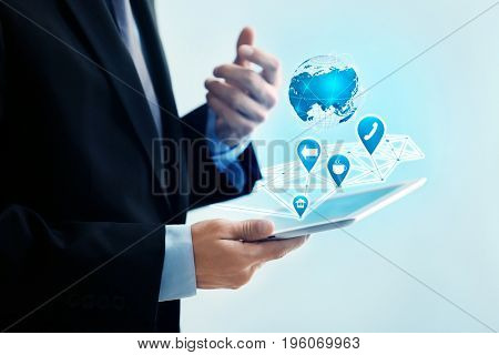 Concept of management information systems. Man using tablet on color background, closeup