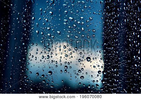 rain droplets on window at twilight