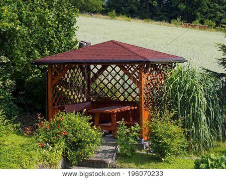 Wooden arbor  in garden
