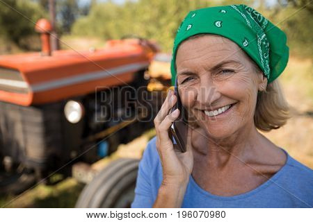 Portrait of happy woman talking on mobile phone on a sunny day