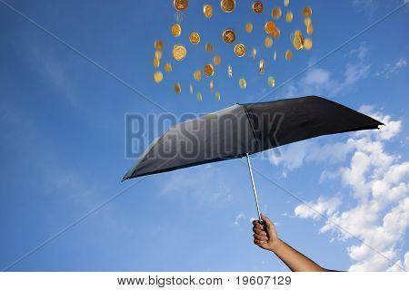 Coins Are Raining Over An Umbrella