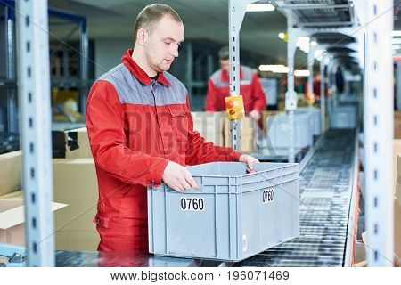 worker with box at warehouse conveyer