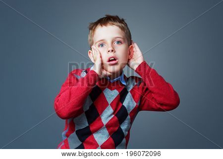 surprised boy listening to something, isolated