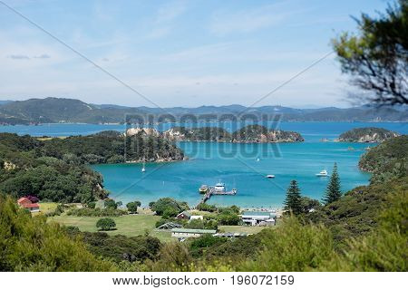 View of Otehei Bay tourist ferry pier with tourboats on Urupukapuka Island in Bay of Islands New Zealand NZ
