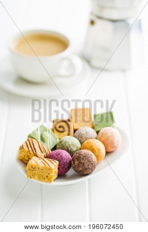Various sweet candies on plate.