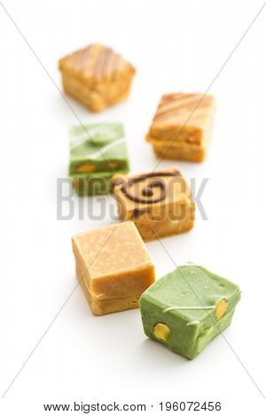 Colorful caramel candies isolated on white background.