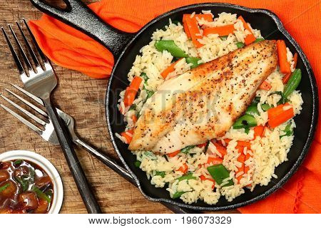 Crispy Catfish and Plum Sauce in Cast Iron Skillet  at Table.