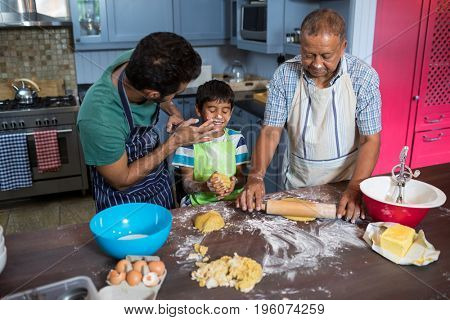 High angle view of playful family preparing food in kitchen at home