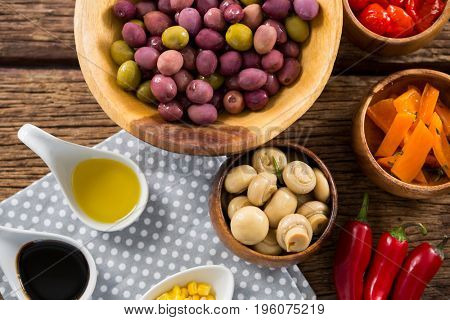 Close-up of marinated olives with various ingredients