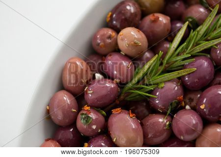 Close-up of olives garnished with rosemary