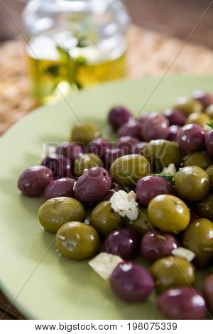 Close-up of marinated olives in plate