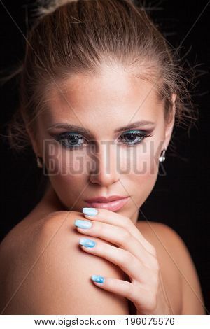 beauty young blonde woman portrait blue eyes hair in bun studio shot front view