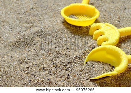 Summer background with sand toys on the beach