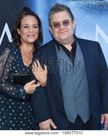 LOS ANGELES - JUL 12:  Meredith Salenger and Patton Oswalt arrives for the Season 8 premiere of HBO's 'Game of Thrones' on July 12, 2017 in Los Angeles, CA