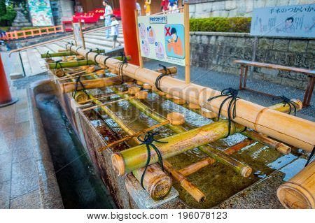 Close up of hand wash pavilion in Fushimi Inari Shrine in Kyoto, Japan poster