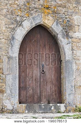 Old wooden door entrance to the european castle