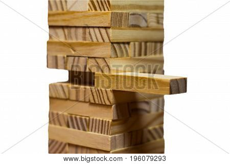 Closeup Take One Block On The Tower From Wooden Blocks, Isolated