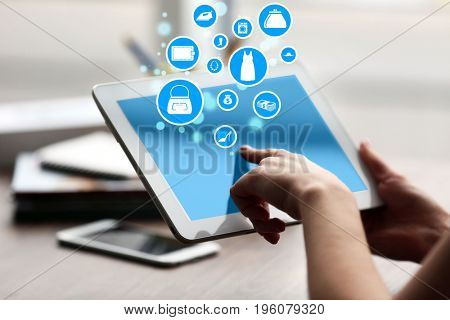 Woman using tablet for browsing internet store, closeup. Online shopping concept