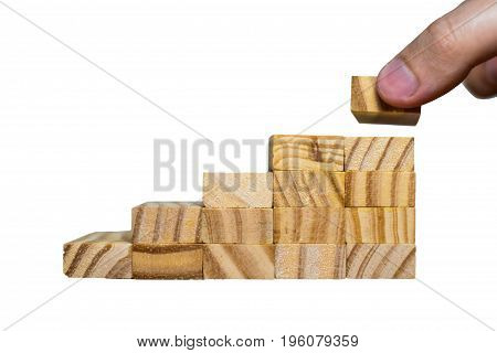Concept Of Building Success Foundation. Hand Put Wooden Blocks In The Shape Of A Staircase Isolated