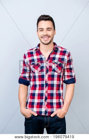 Success Concept. Smiling Young Stylish Bearded Brunet Student In Bright Casual Checkered Shirt Is St