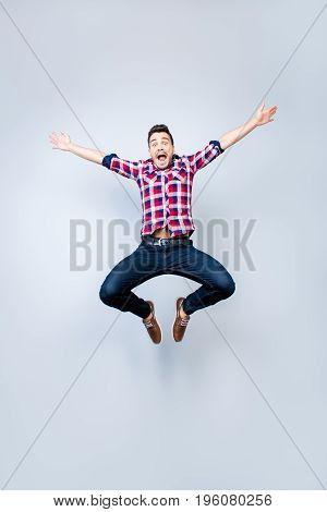 Freedom, Crazy, Funky, Carefree, Summer Mood. Excited Brunete Guy Is Jumping And Fooling Around. He