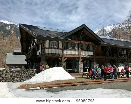 KAMIKOCHI JAPAN - APRIL 20 2017: Information center in the National Park of Kamikochi on the background of the mountains