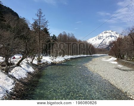 Mountains in the Kamikochi National Park and the unfrozen Azuza River