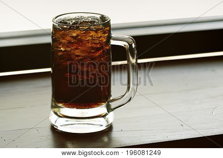 glass of cola with ice with copy-space in composition