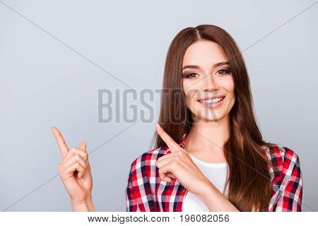 Close Up Of Young Brunette Girl On The Pure Light Blue Background, She Is Smiling, Wearing Casual Ou