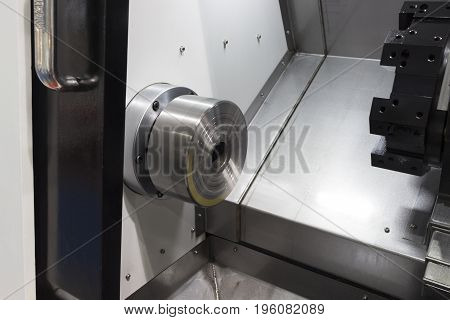 Inside CNC Lathe machine without workpice and tools;opern door
