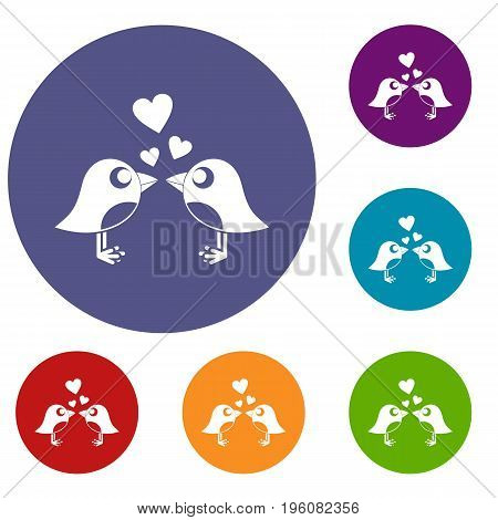 Two birds with hearts icons set in flat circle red, blue and green color for web