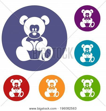 Teddy bear holding a heart icons set in flat circle red, blue and green color for web