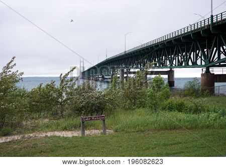 MACKINAW CITY, MICHIGAN / UNITED STATES - JUNE 18, 2017:  The Mackinac Bridge spans the Straits of Mackinac, between Lakes Michigan and Huron, to connect Michigan's Lower and Upper Peninsulas, from Mackinaw City to St. Ignace.
