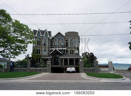 MACKINAW CITY, MICHIGAN / UNITED STATES - JUNE 18, 2017: A large lakefront home with a below ground garage in Mackinaw City.