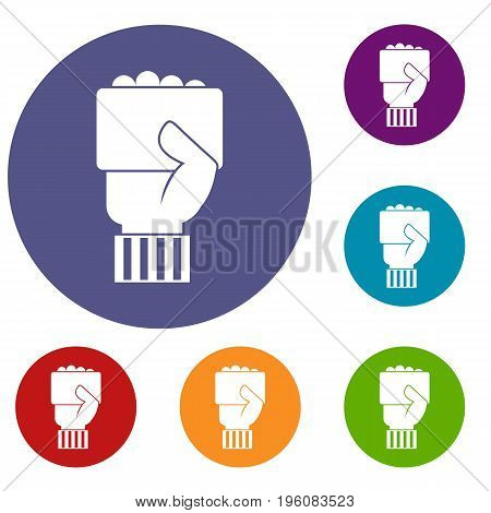 Hand of soccer referee showing card icons set in flat circle red, blue and green color for web