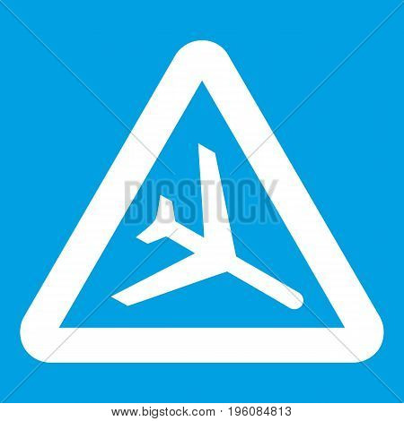 Warning sign of low flying aircraft icon white isolated on blue background vector illustration