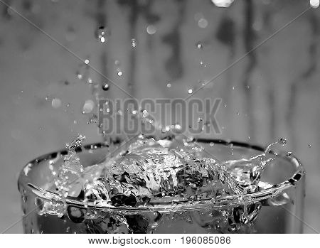 Water Dispersed On A Glass Of Splash, Abstract Image, Black And White Image.