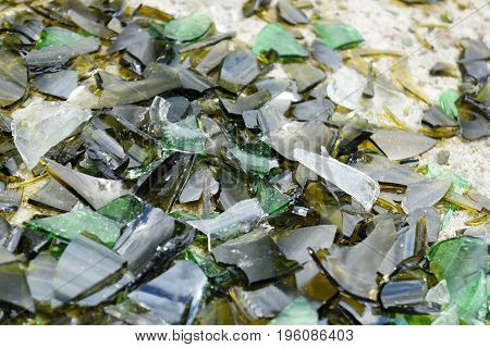 Fragments Of Colored Broken Glass On A Concrete Surface