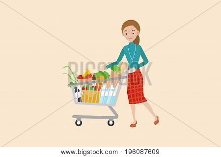 Women pushing a shopping cart full of groceries.