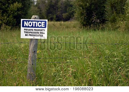 An image of a blue no trespassing sign.