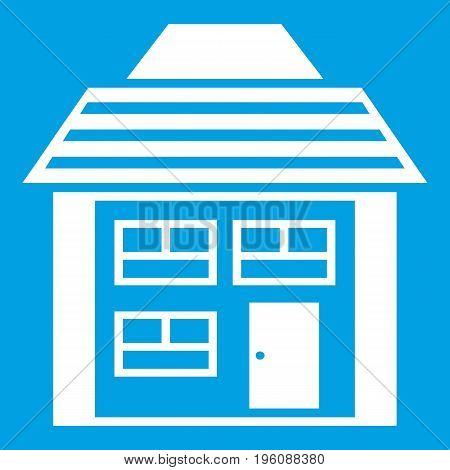 Two-storey house with sloping roof icon white isolated on blue background vector illustration