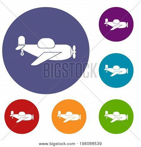 Toy plane icons set in flat circle red, blue and green color for web