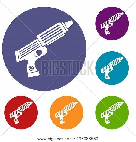 Plastic gun toy icons set in flat circle red, blue and green color for web