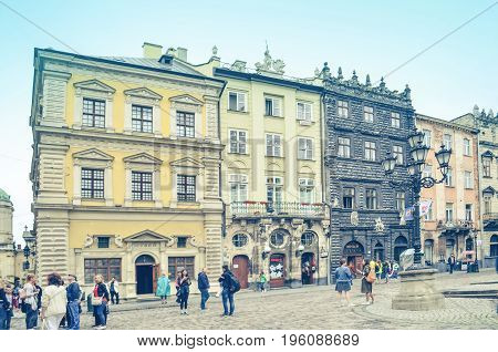 Lviv,Ukraine - JULY 15, 2017: Cityscape of Lviv. Medieval architecture of the Central European cities. Old European city Lviv. Cobbled Lviv street with tram tracks