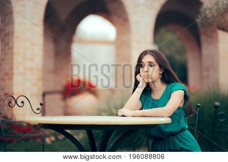 Sad Woman Being Stood Up on a Date in a Restaurant