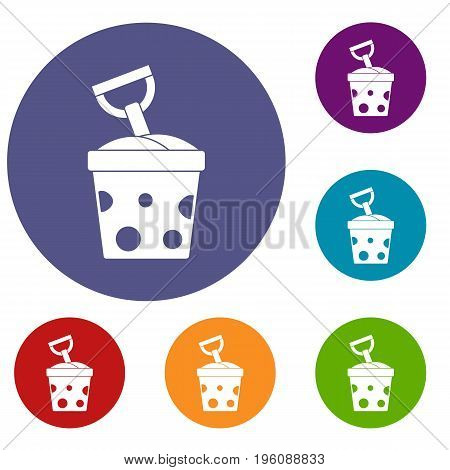 Toy bucket and shovel icons set in flat circle red, blue and green color for web