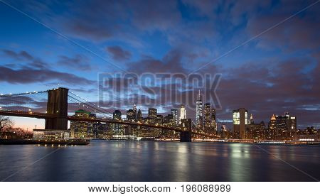 New York City and Brooklyn Bridge at sunset