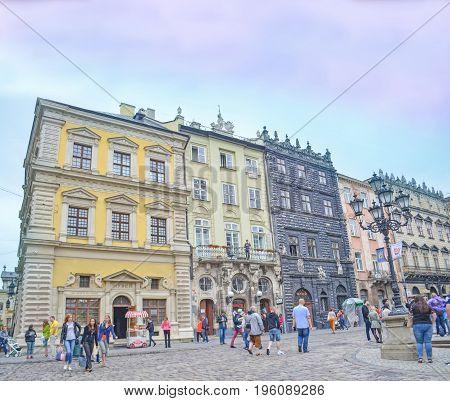 Lviv,Ukraine - JULY 15, 2017: Cityscape of Lviv. Central square in Lviv. The area the market. Old European city Lviv. Cobbled Lviv street with tram tracks
