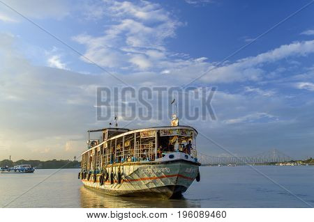 July 15,2017. Babughat, Kolkata,West Bengal,India.  Ferry service from Babughat on the river Hooghly overlooking the historic Howrah bridge in Kolkata.