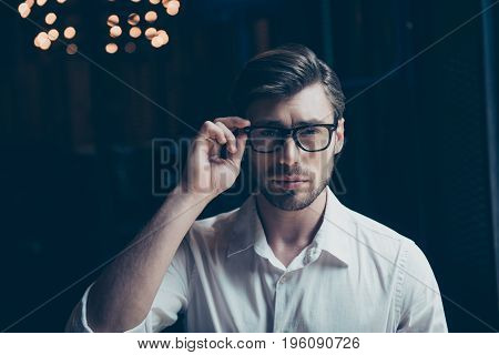 Close Up Of Successful Young Guy With Bristle In Classy Shirt, Adjusting Trendy Glasses. So Stylish